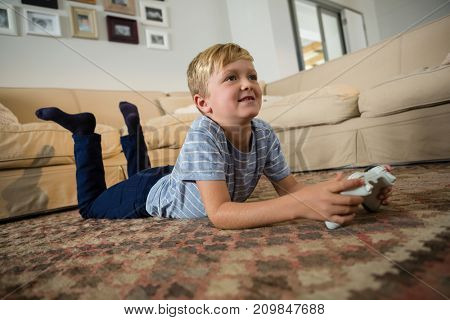 Boy playing video game in the living room at home