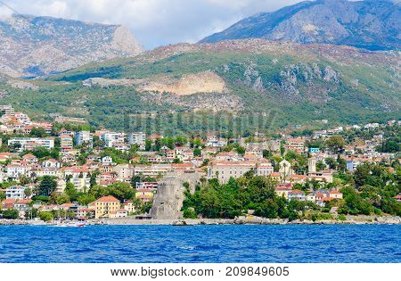 Beautiful view of resort town of Herceg Novi and fortress of Forte Mare from sea Montenegro