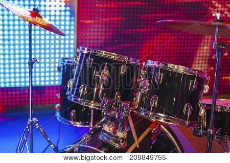 Modern drum kit at discotheque. Musical instruments