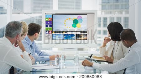 Business people looking at blank whiteboard in conference room against digitally generated image of various video and icons displayed