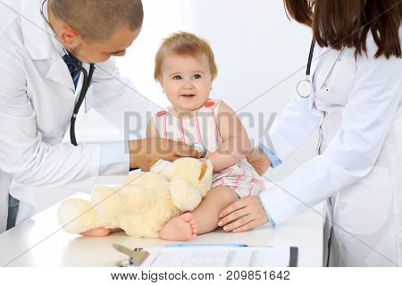 Doctor and patient. Happy cute baby  at health exam. Medicine and health care concept.