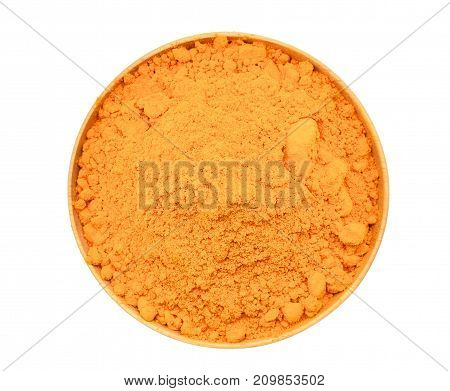 top view of turmeric powder in wooden bowl isolated on white background
