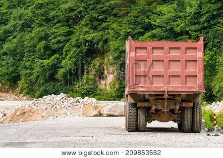 A big truck, driving in mountain road