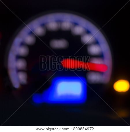 Defocused modern car dashboard. Bokeh background. Concept of drunkenness driving. Over speed