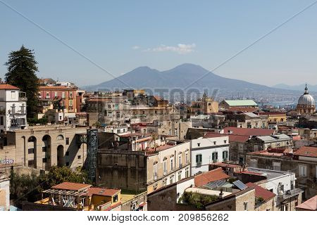 panorama of napoli with vesuvius,cloiuds and buildings