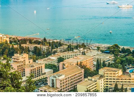 View of the hotels and the crowded beaches of the resort town of Becici, Budva Riviera, Montenegro.