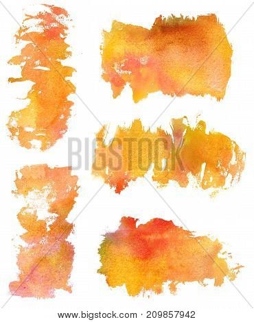 A set of golden toned watercolor stains on white background, artistic textures for design