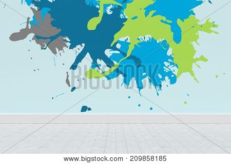 Colourful paint splashes against blue wall by hardwood floor
