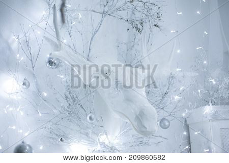 white wooden moose head on the wall in Christmas decorations
