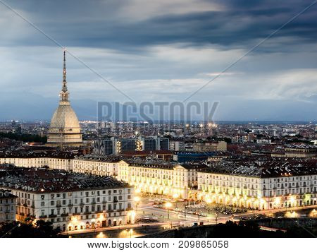 Cityscape of Torino (Turin Italy) at sunset cloudy sky