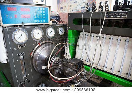 close-up high pressure diesel fuel pump test bench on work
