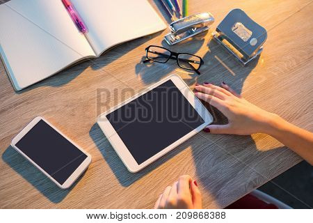 Female executive working at her desk in office
