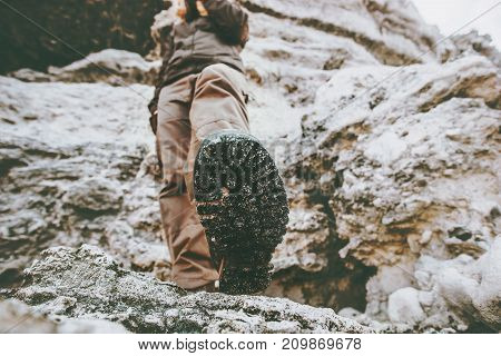Traveler climbing at rocky mountains Travel Lifestyle wanderlust adventure concept summer vacations view under feet boots perspective