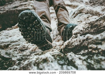 Trekking boots feet traveler climbing at rocky mountains Travel Lifestyle wanderlust adventure concept summer vacations view under sole perspective