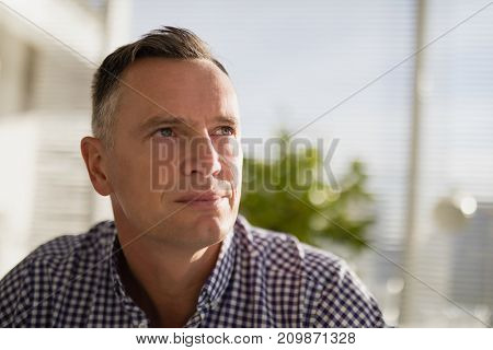 Thoughtful business executive in office