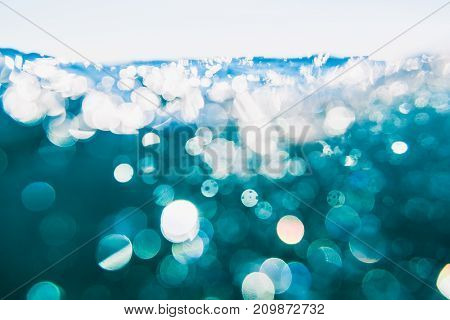 Underwater air bubbles in ocean. Water texture with bokeh.