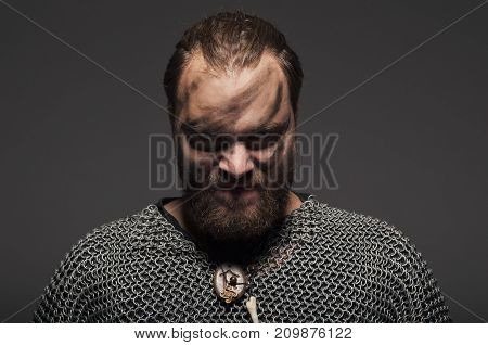 Formidable Viking In Chain Armor Over Grey Background