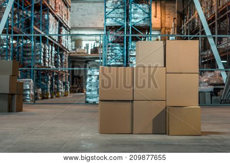 view of cardboard boxes in modern warehouse interior
