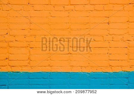 brick wall painted wit orange-blue color. saturated color.