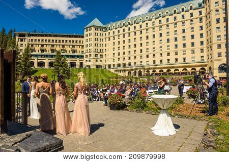 LAKE LOUISE, ALBERTA, CANADA - JUNE 27, 2017 : Wedding ceremony at the Fairmont Chateau Lake Louise in canadian Rocky Mountains.