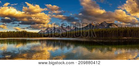 Sunset panorama of Herbert Lake along the roadside of the Icefields Parkway in Banff National Park, Alberta, Canada.