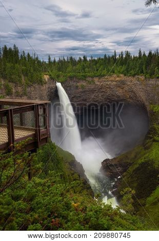 Helmcken Falls and an outlook platform in Wells Gray Provincial Park near Clearwater, British Columbia, Canada. Long exposure.