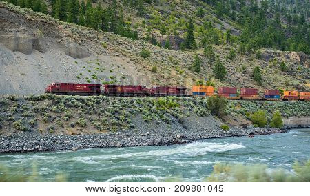 EPSOM PROVINCIAL PARK, CANADA - JULY 2, 2017: Freight train of Canadian Pacific Railway moving along the Thompson River.