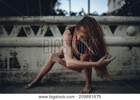Woman performing wild dance on the floor.