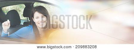 Portrait of teenage girl sitting in car holding keys