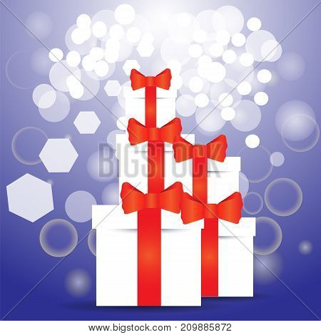 White paper gift boxes on blue blurred background