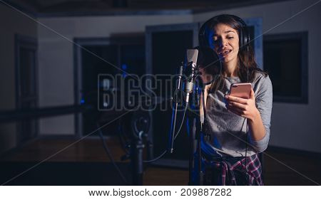 Female Playback Singer With Mobile Phone