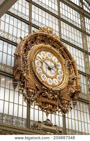 Paris, France, March 28 2017: Golden clock of the museum D'Orsay.The Musee d'Orsay is a museum in Paris, on the left bank of the Seine