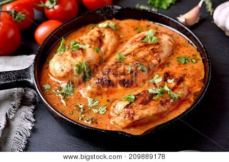 Chicken Breast With Tomato Sauce In Frying Pan