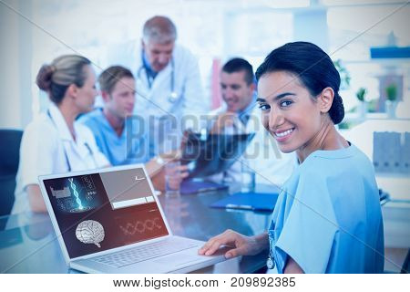 Beautiful smiling doctor typing on keyboard with her team behind against human brain with dna structure and reports