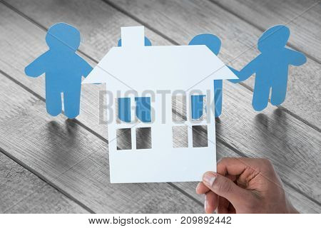 High angle view of white paper cut out figures on wooden table