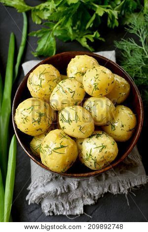 Vegetarian natural food. Tasty new boiled potatoes with dill in bowl