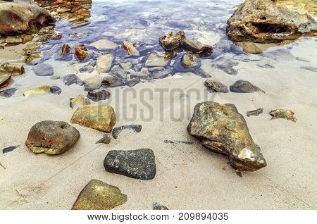 Natural background with beach, stones and sea