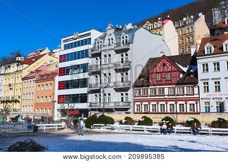 Karlovy Vary, Czech Republic - February 15, 2017: Street view, houses and people in famous spa town