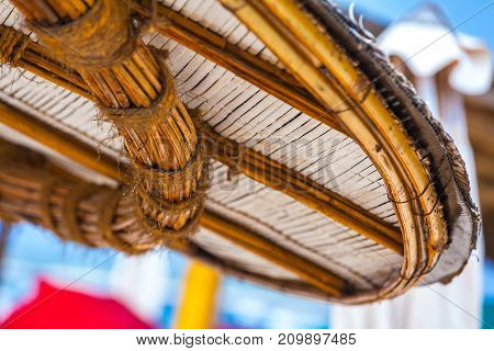 The round bamboo roof is tied with ropes drenched with rain. Life and interior items of the Gili Trawangan island, Indonesia.