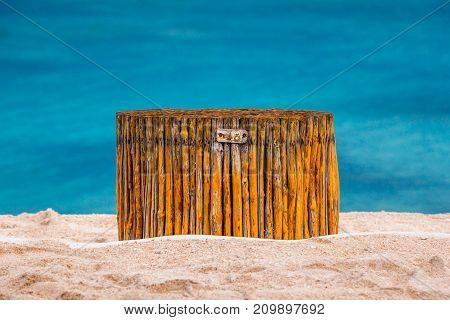 The seat is made of bamboo rods on a sandy beach on the background of the sea. Located in the middle. 48 hours on the beach, Gili Trawangan, Indonesia.