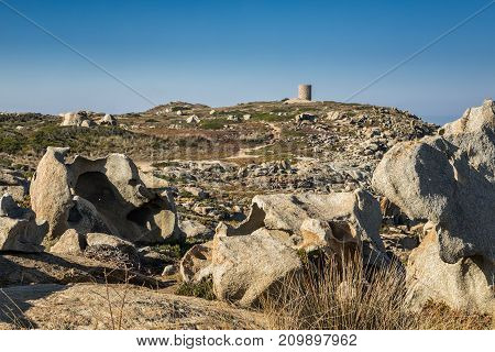 Rock Formations And Genoese Tower At Punta Spano In Corsica