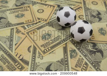 Close-up of footballs on a currency notes