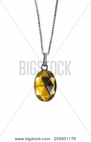 Yellow crystal faceted medallion hanging on a chain isolated over white