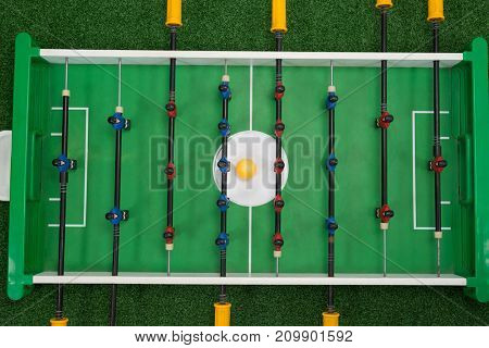 Overhead view of table soccer game on artificial grass