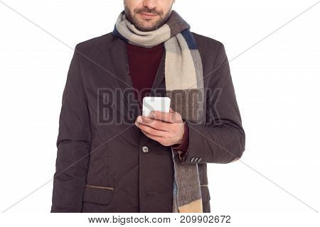 cropped view of man using smartphone isolated on white