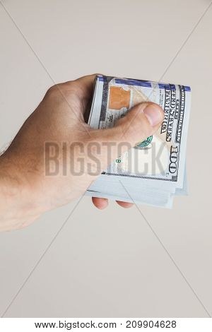 One Hundred Dollars Notes In Male Hand