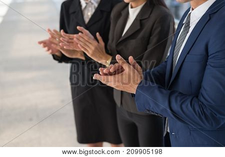business man and business woman clap their hands to congratulate the signing of an agreement or contract between their firms companies enterprises. success dealing greeting and partner concept.