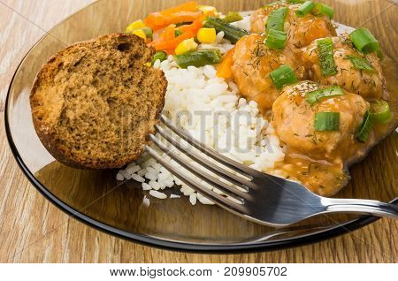 Close Up Of Plate With Meatballs, Rice, Vegetable Mix, Bun