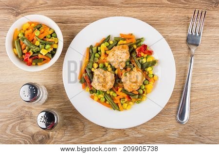 Plate With Vegetable Mix And Meatballs, Salt, Pepper And Fork