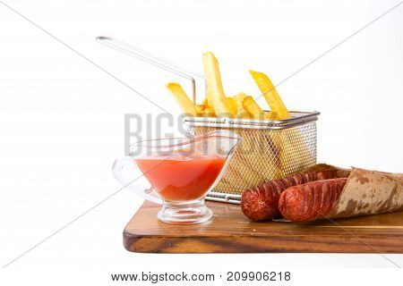 Grilled Sausages With French Fries Served On Wooden Board Isolated At The White Background